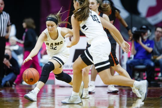 Southeast Polk's Maggie McGraw (32) chases down a loose ball during their 5A girls state basketball championship game on Friday, March 1, 2019 in Des Moines. Southeast Polk takes a 32-27 lead over Valley into halftime.