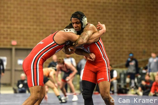 Grand View's Renaldo Rodriguez-Spencer works for inside control against Grand View's Steven Lawrence in the quarterfinals of the 2019 NAIA National Championships on Friday in Des Moines. Rodriguez-Spencer won, 5-3, in overtime to advance to the semifinals at 157 pounds.