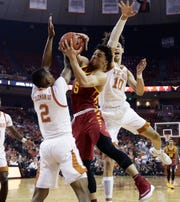 Iowa State guard Lindell Wigginton (5) drives to the basket against Texas guard Matt Coleman III (2) and forward Jaxson Hayes (10) during the first half of an NCAA college basketball game, Saturday, March 2, 2019, in Austin, Texas.