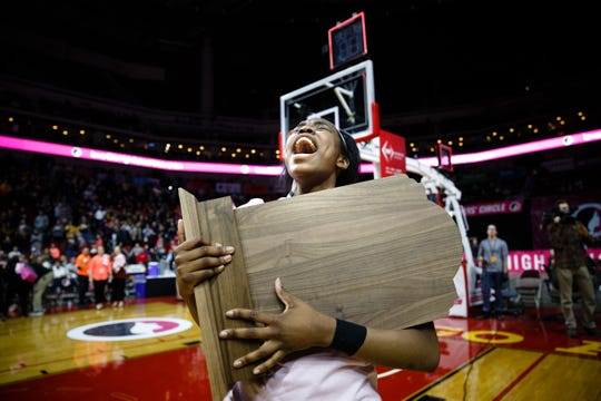 Valley's Zoe Young (3), right, holds onto the trophy as Valley celebrates its 65-60 win over Southeast Polk to win the girls 5A state championship on Friday, March 1, 2019 in Des Moines.