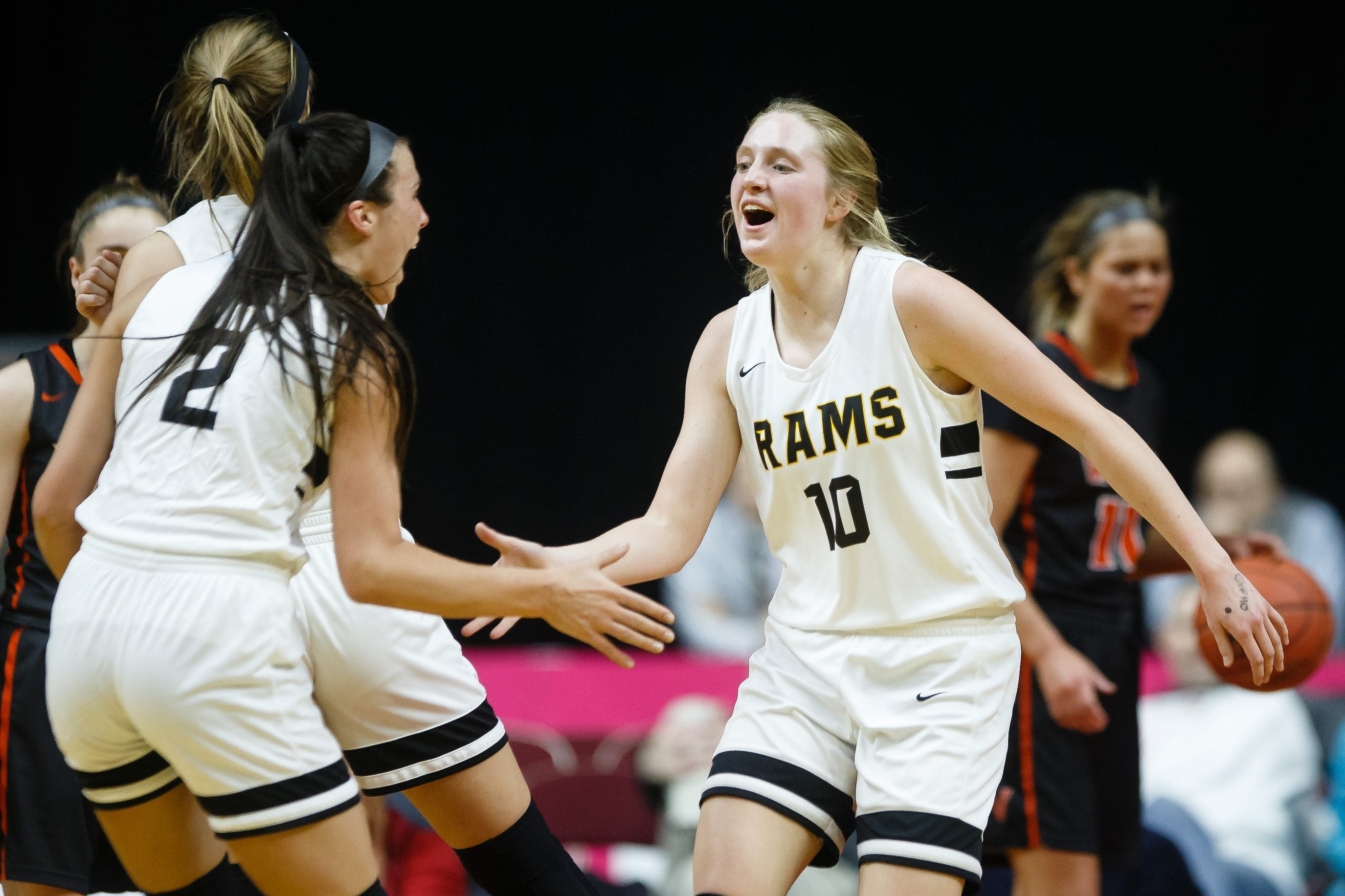 Southeast Polk's Grace Larkins (10) high-fives Liza Sutten (2) after knocking down a three during a Class 5A state basketball championship game in March.