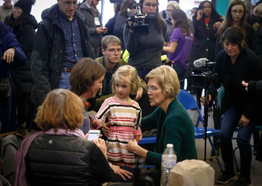 Democratic presidential hopeful Elizabeth Warren meets with supporters after speaking at the Black Hawk Democratic headquarters in Waterloo on Saturday, March 2, 2019.