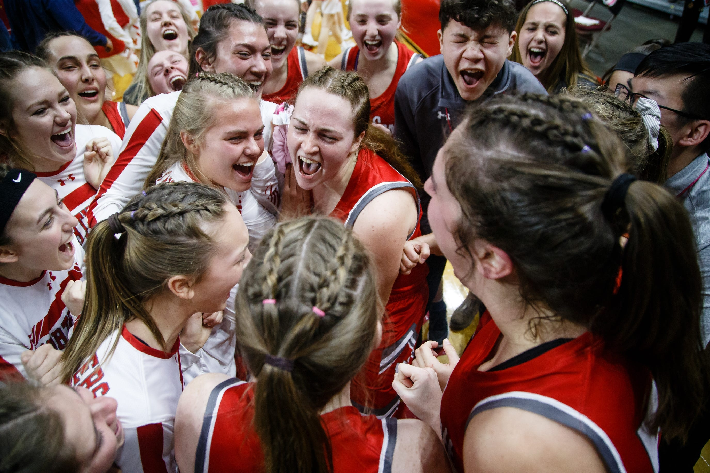 North Scott celebrates its 50-49 victory over Marion during their 4A girls state basketball championship game on Saturday, March 2, 2019 in Des Moines.