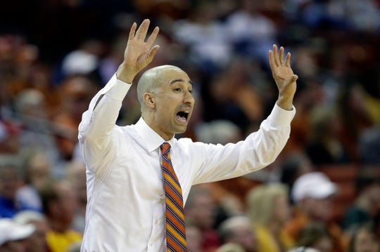 Texas head coach Shaka Smart directs his players during the first half of an NCAA college basketball game against Iowa State, Saturday, March 2, 2019, in Austin, Texas.
