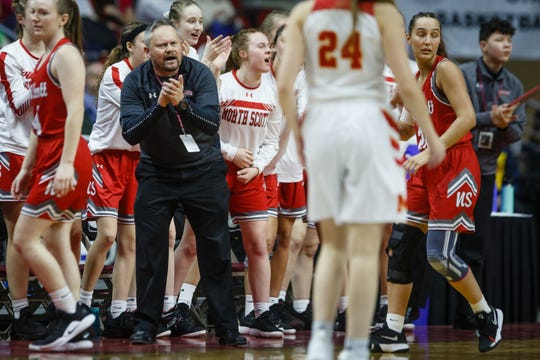 North Scott head coach T.J. Case cheers on his team during their 4A girls state basketball championship game on Saturday, March 2, 2019 in Des Moines. North Scott takes a 33-25 lead over Marion into halftime.
