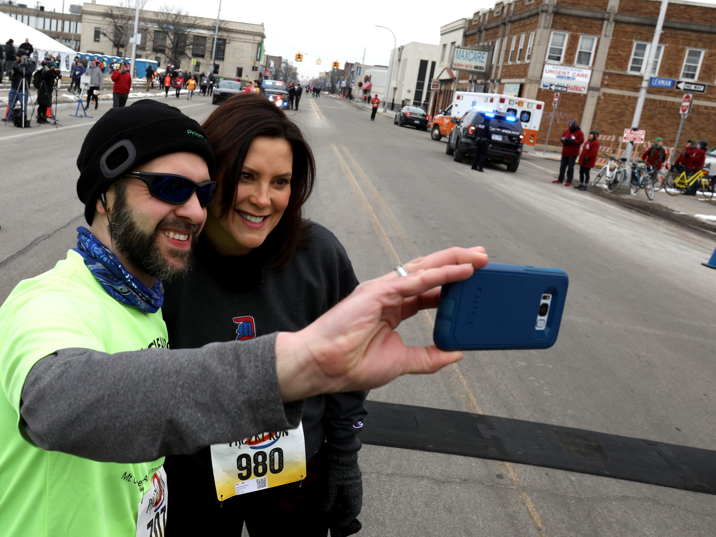 Before the start of the 2019 Paczki 5K run in downtown Hamtramck on Saturday, March 2, 2019 runner Jason Davidson, 40 of Clinton Township takes a selfie with Governor Gretchen Whitmer.