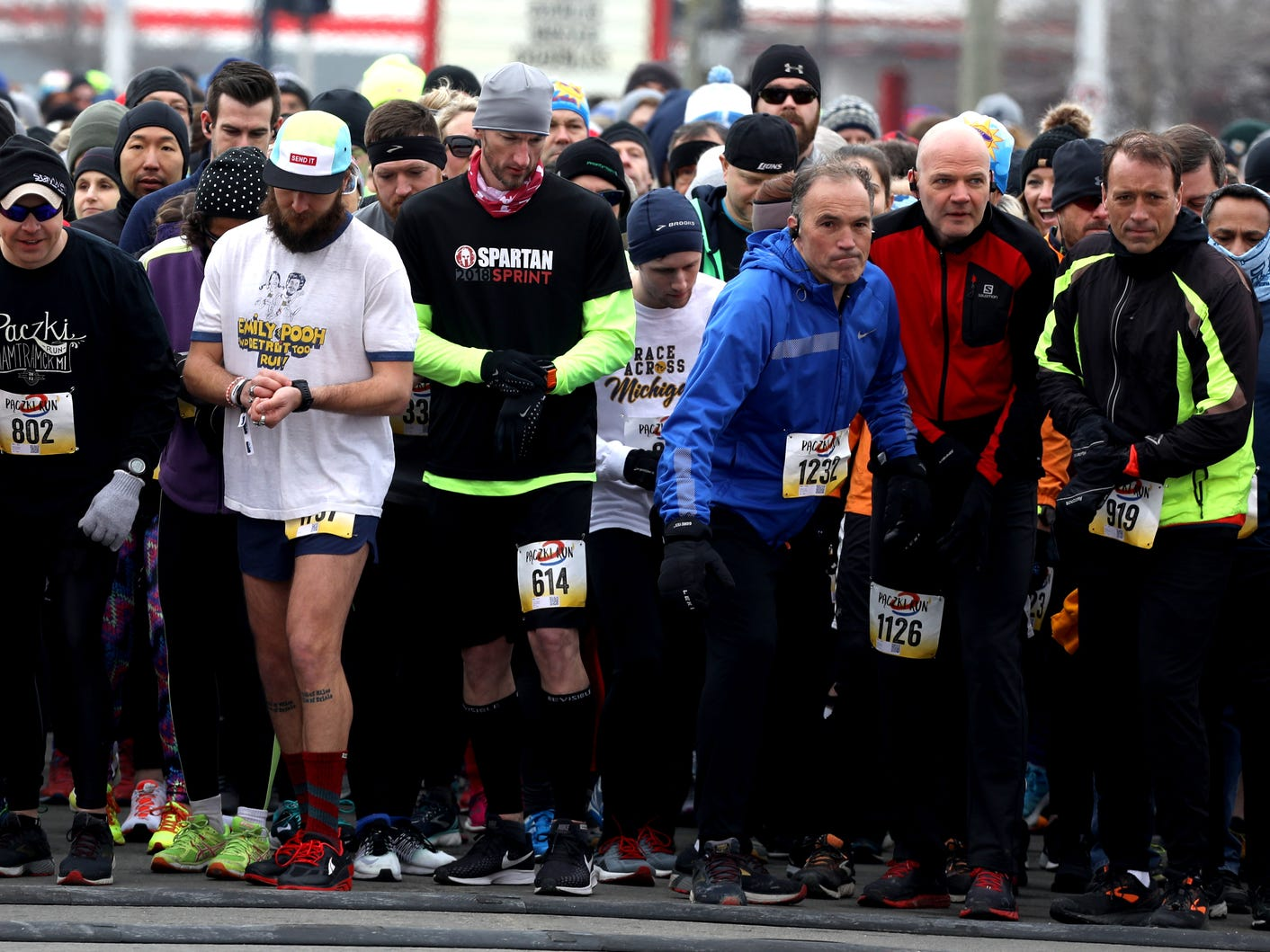 Runners lean forward as the countdown hits zero to start the 2019 Paczki 5K run through the streets and neighborhoods of downtown Hamtramck on Saturday, March 2, 2019.