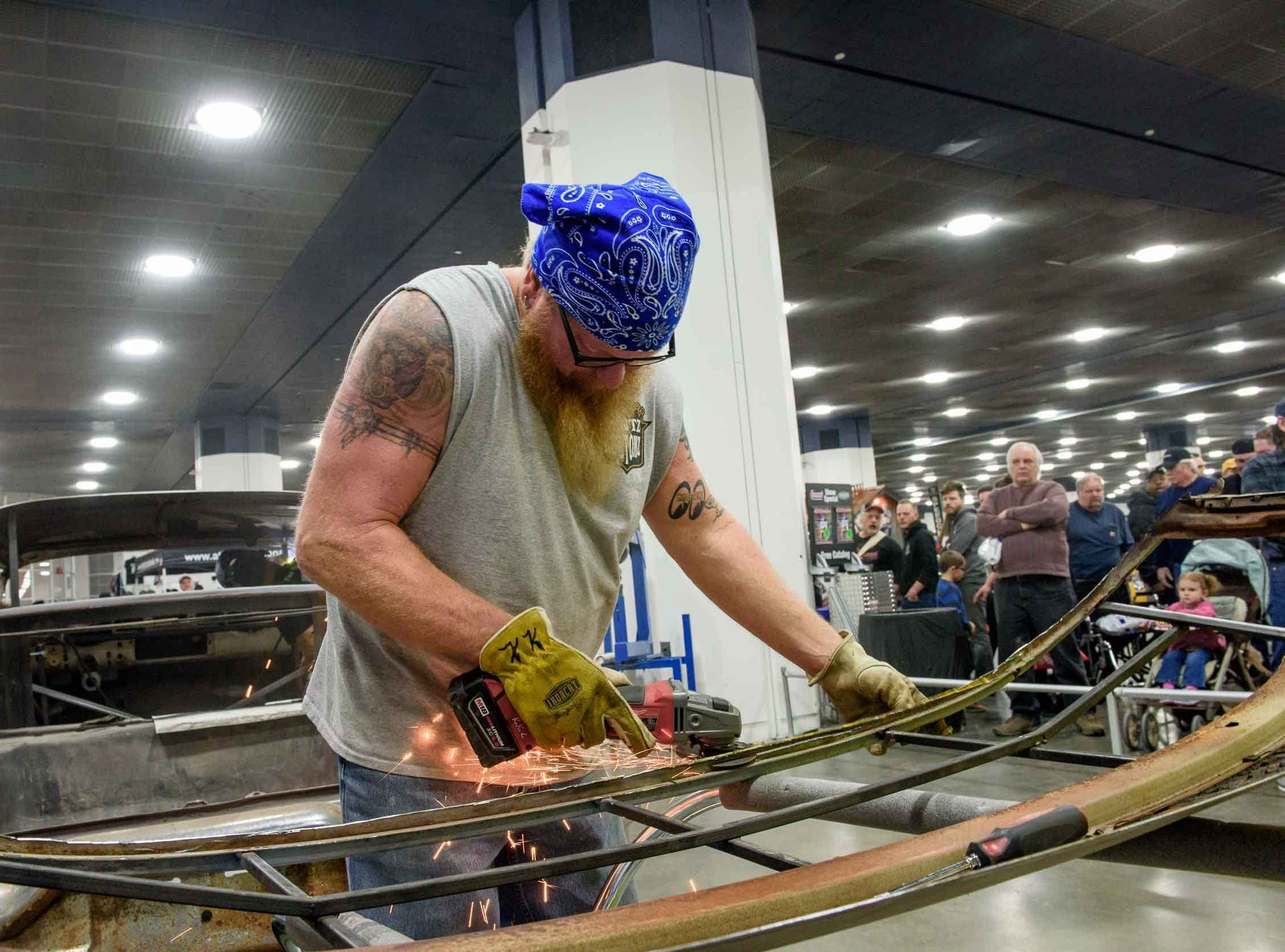 Automotive customizer Kent Writtenberry of Kentz Kustomz, Gasburg, Virginia  demonstrates metal fabricating techniques for fans during Autorama 2019 at Cobo Center, March 2, 2019.