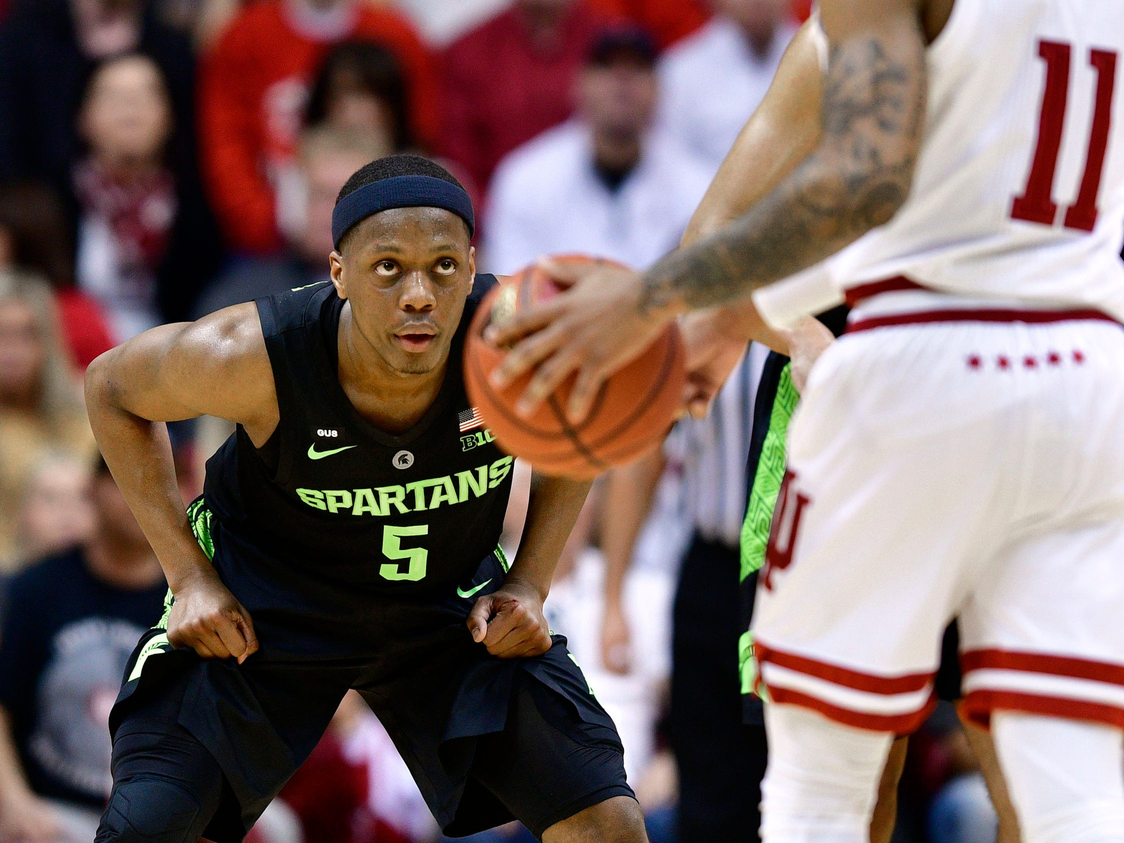 Michigan State guard Cassius Winston in his defensive stance guarding Indiana guard Devonte Green during the second half March 2, 2019, in Bloomington, Ind.