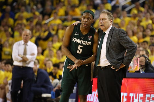 Cassius Winston talks with Michigan State coach Tom Izzo during the win over Michigan at Crisler Center on Feb. 24, 2019 in Ann Arbor.