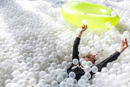 Riley Raznick, 9 of Bloomfield Hills enjoys her swim session at The Beach Detroit, a massive ball pit that opened to the public this weekend in downtown Detroit and is photographed on Saturday, March 2, 2019.