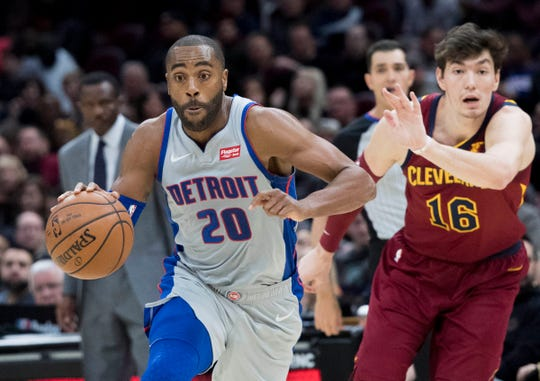 Detroit Pistons guard Wayne Ellington drives to the basket past Cleveland Cavaliers forward Cedi Osman during the first half at Quicken Loans Arena, March 2, 2019.