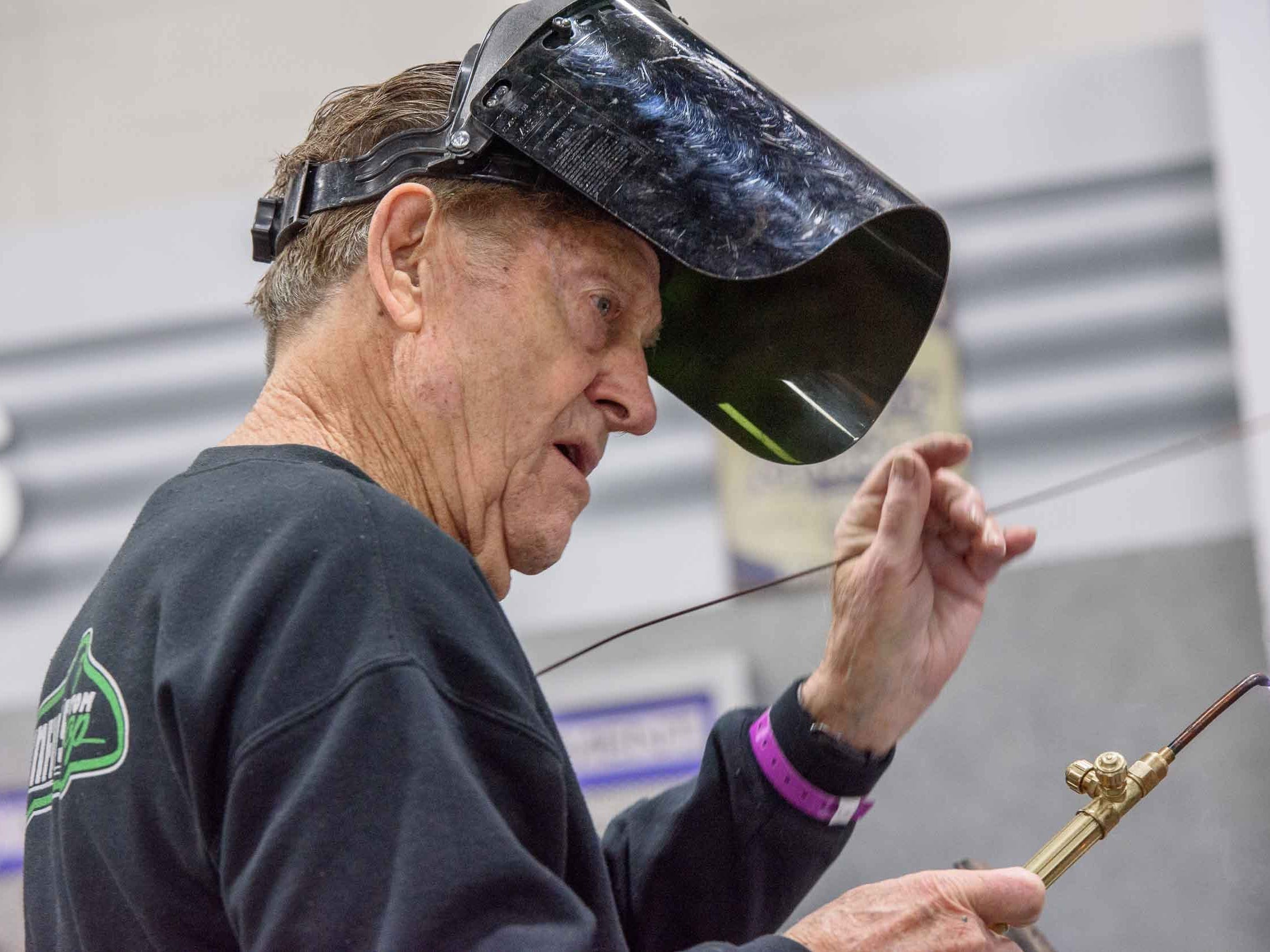 Legendary automotive customizer Gene Winfield demonstrates metal fabricating techniques for fans during Autorama 2019 at Cobo Center, March 2, 2019.