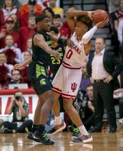 Indiana's Romeo Langford is trapped by Michigan State's Aaron Henry, Saturday, March 2, 2019, in Bloomington, Ind.