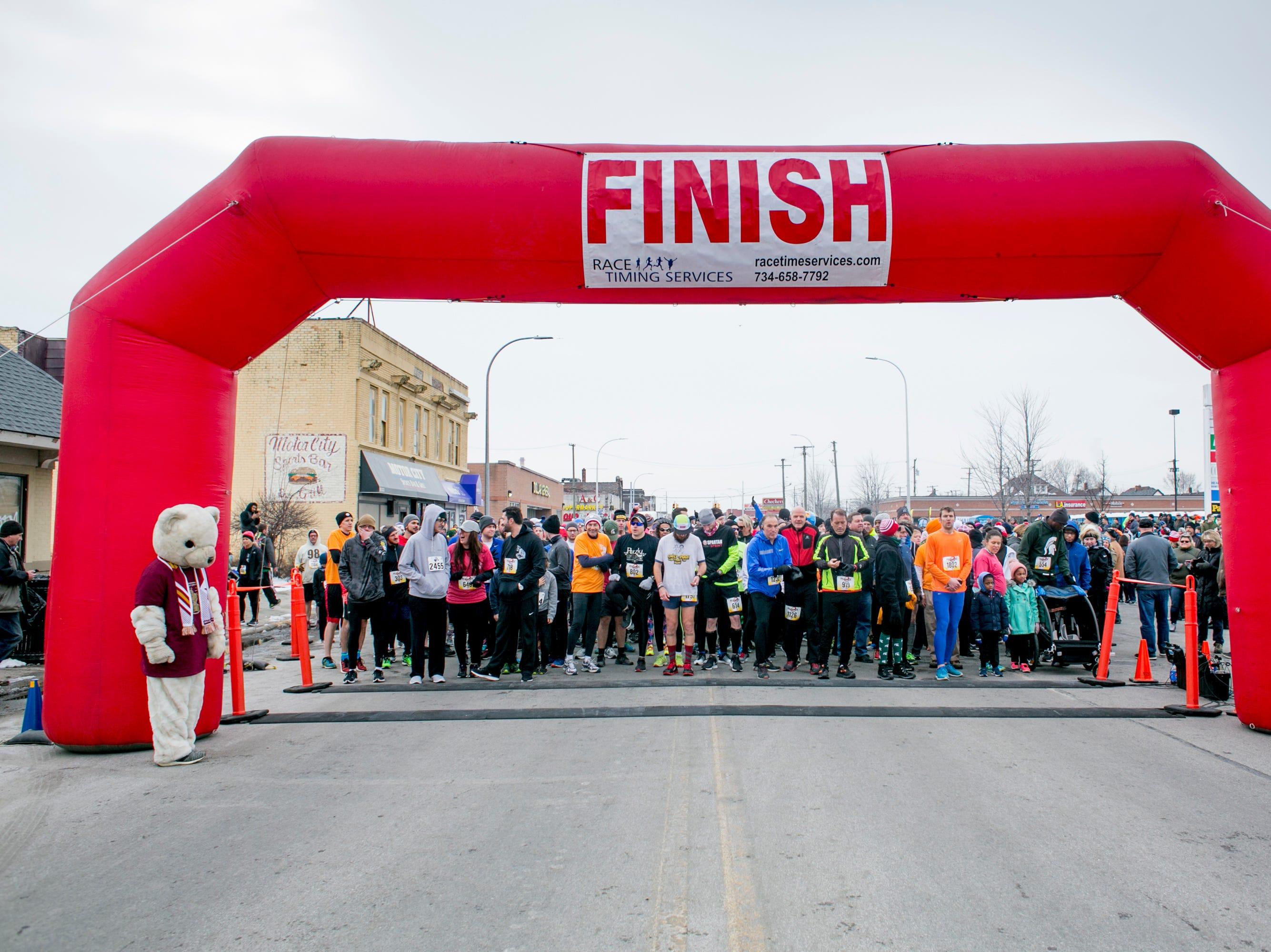 Runners line up before the start of the Paczki Run.