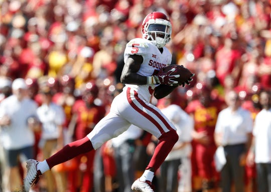 Oklahoma wide receiver Marquise Brown was held out of NFL Combine drills because of a foot injury.