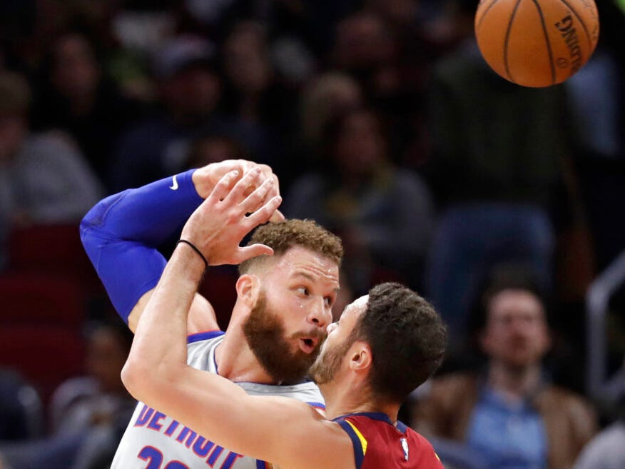 Detroit Pistons' Blake Griffin (23) passes the ball over Cleveland Cavaliers' Larry Nance Jr. (22) in the first half.