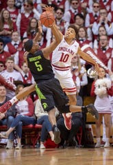 Indiana guard Rob Phinisee (10) blocks the shot of Michigan State guard Cassius Winston (5) during the second half Saturday.