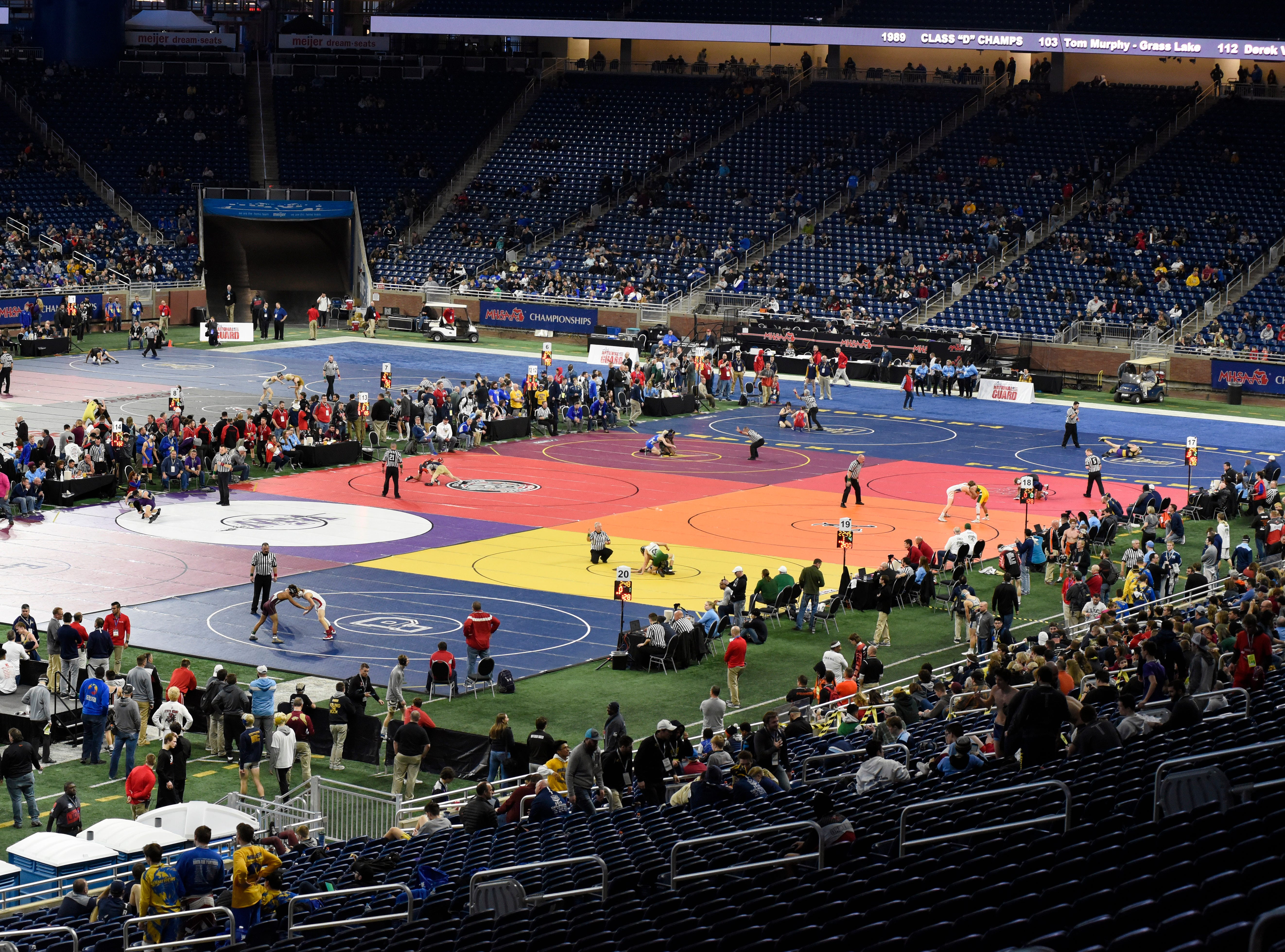 The MHSAA wrestling quarterfinals take place on multiple mats at Ford FIeld in Detroit Friday.