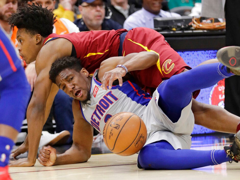 Detroit Pistons' Langston Galloway, bottom, and Cleveland Cavaliers' Collin Sexton battle for a loose ball in the first half on Saturday, March 2, 2019, in Cleveland.