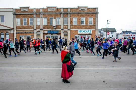 Hamtramck Mayor Karen Majewski takes photos at the 7th annual Paczki Run in Hamtramck on March 2, 2019.