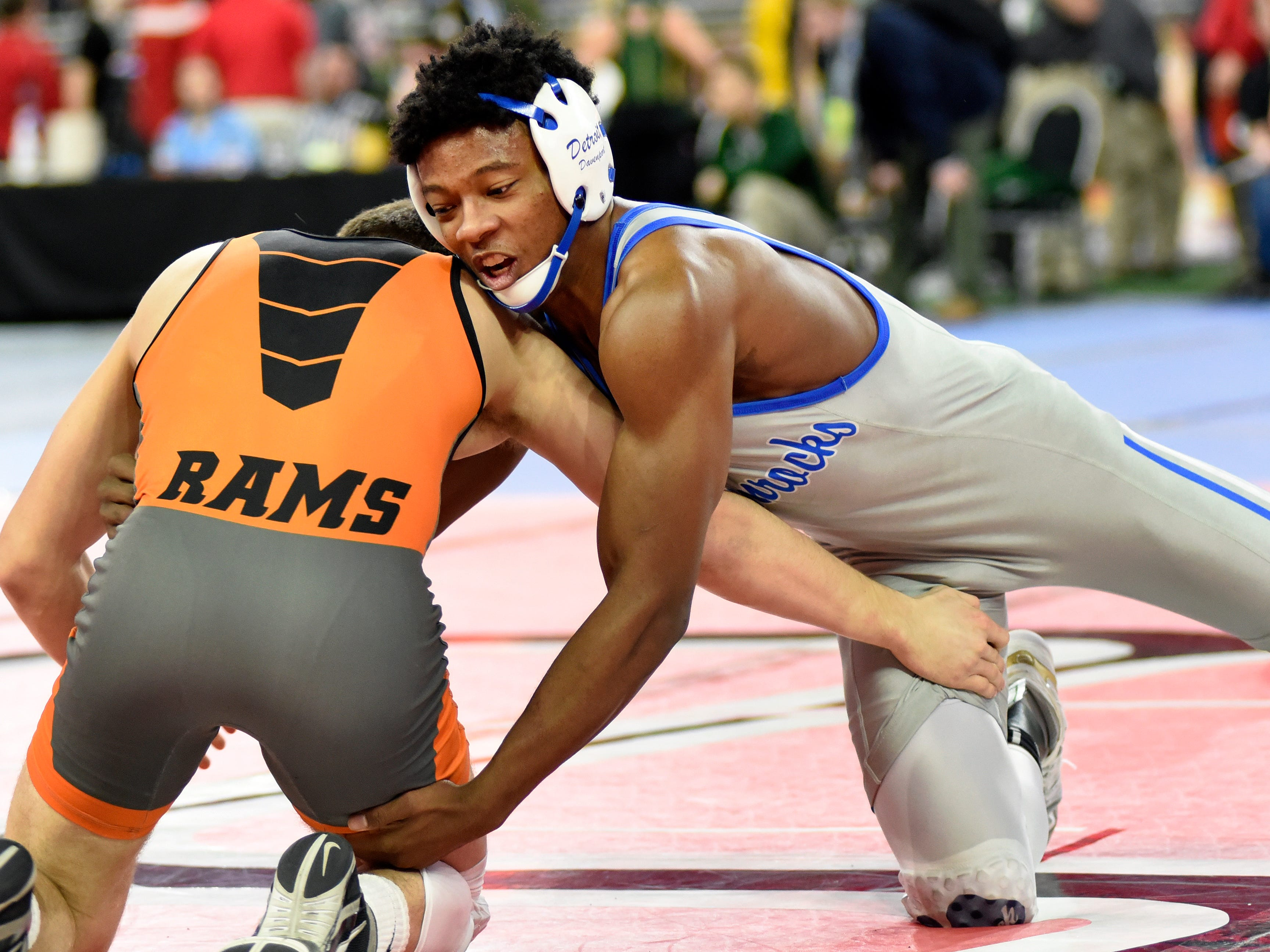 Kevon Davenport of Detroit Catholic Central, right, wrestles Jack Richardson of Rockford at 145 pounds, Friday, March 1, 2019 during the MHSAA wrestling quarterfinals held at Ford Field in Detroit.  Davenport won by pin over Richardson.