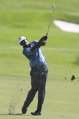 Vijay Singh plays his second shot on the first hole.