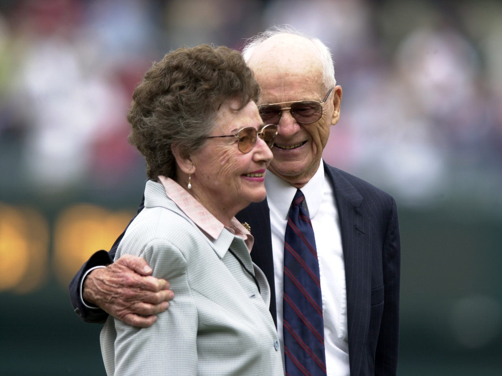 Ernie Harwell smiles at wife Lulu during a ceremony at Comerica Park in 2002.