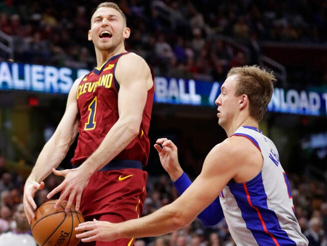 Detroit Pistons' Luke Kennard, right, knocks the ball loose from Cleveland Cavaliers' Nik Stauskas in the first half.