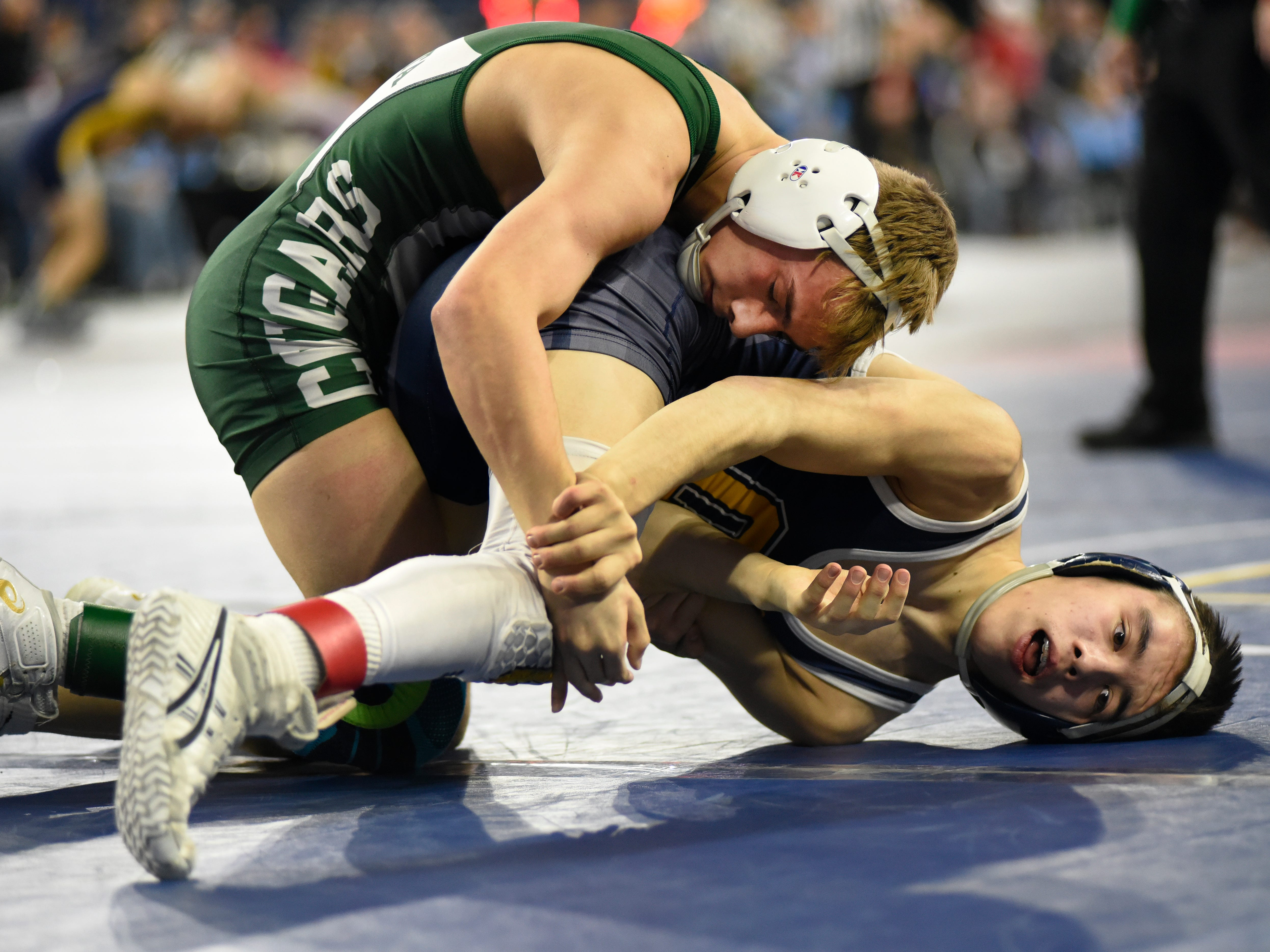 Brendan Ferretti of Macomb Dakota, left, wrestles Darren McLeod of Oxford in the 112 pound weight class, Friday. Ferretti won by decision over McLeod.