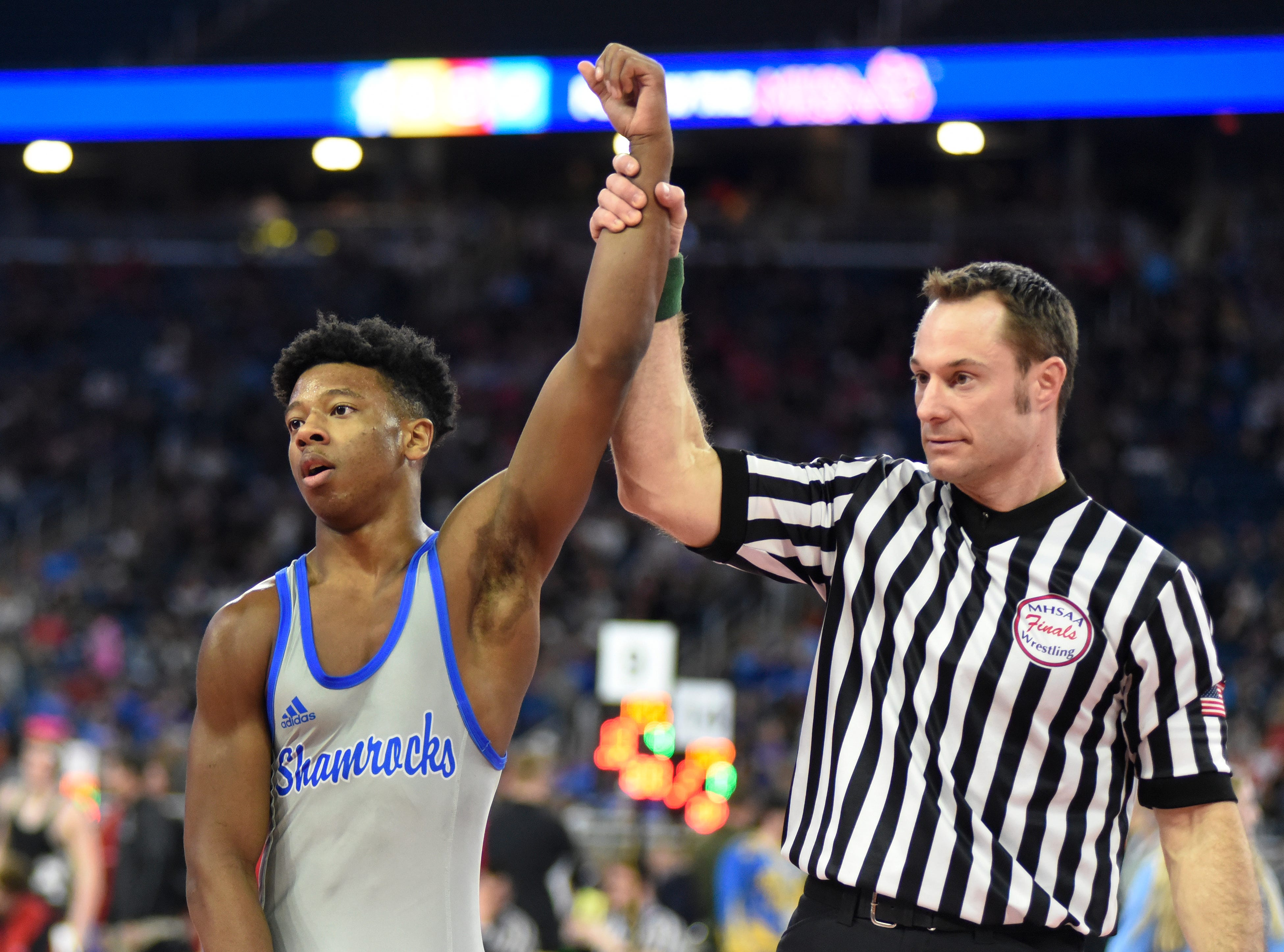 Kevon Davenport of Detroit Catholic Central won by pin over Jack Richardson of Rockford at 145 pounds to advance to the state semifinals match.