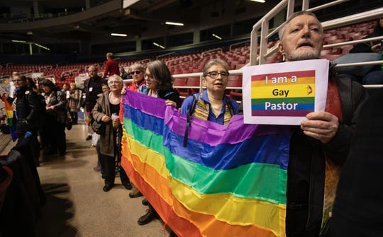 Mark Thompson from Lansing Central United Methodist Church in the Michigan Conference joins others holding banners and singing before the afternoon session at the 2019 Special Session of the United Methodist General Conference in St. Louis on Feb. 24.
