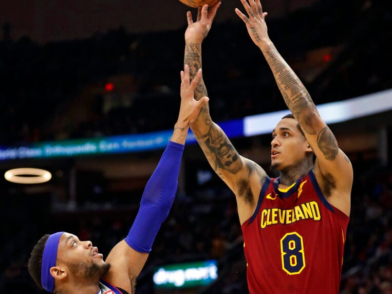 Cleveland Cavaliers' Jordan Clarkson (8) shoots over Detroit Pistons' Bruce Brown (6) in the first half.