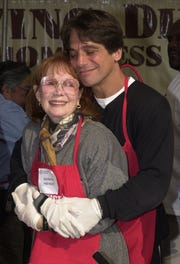 "Actor Tony Danza hugs Katherine Helmond as they prepare to help serve free dinners to the homeless at the Los Angeles Mission during ""The Great Thanksgiving Banquet"" November 22, 2000 in Los Angeles."