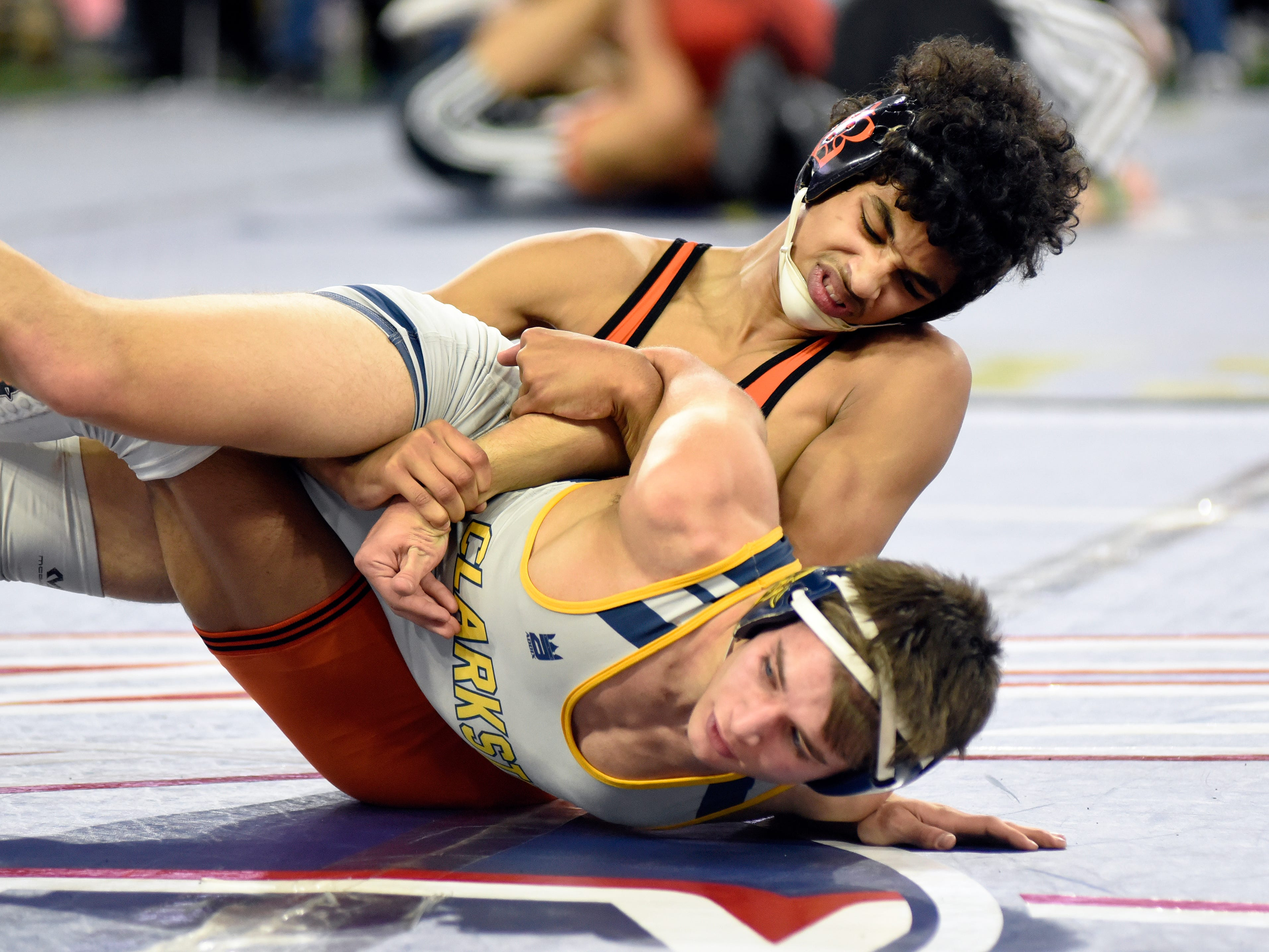 Rhett Newton of Brighton, top, wrestles Ethan Polick of Clarkston in a 140-pound quarterfinal match Friday. Newton won by major decision over Polick.