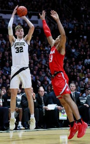 Purdue center Matt Haarms (32) shoots the basketball defended by Ohio State forward Jaedon Ledee in the second half Saturday. Purdue won 86-51.