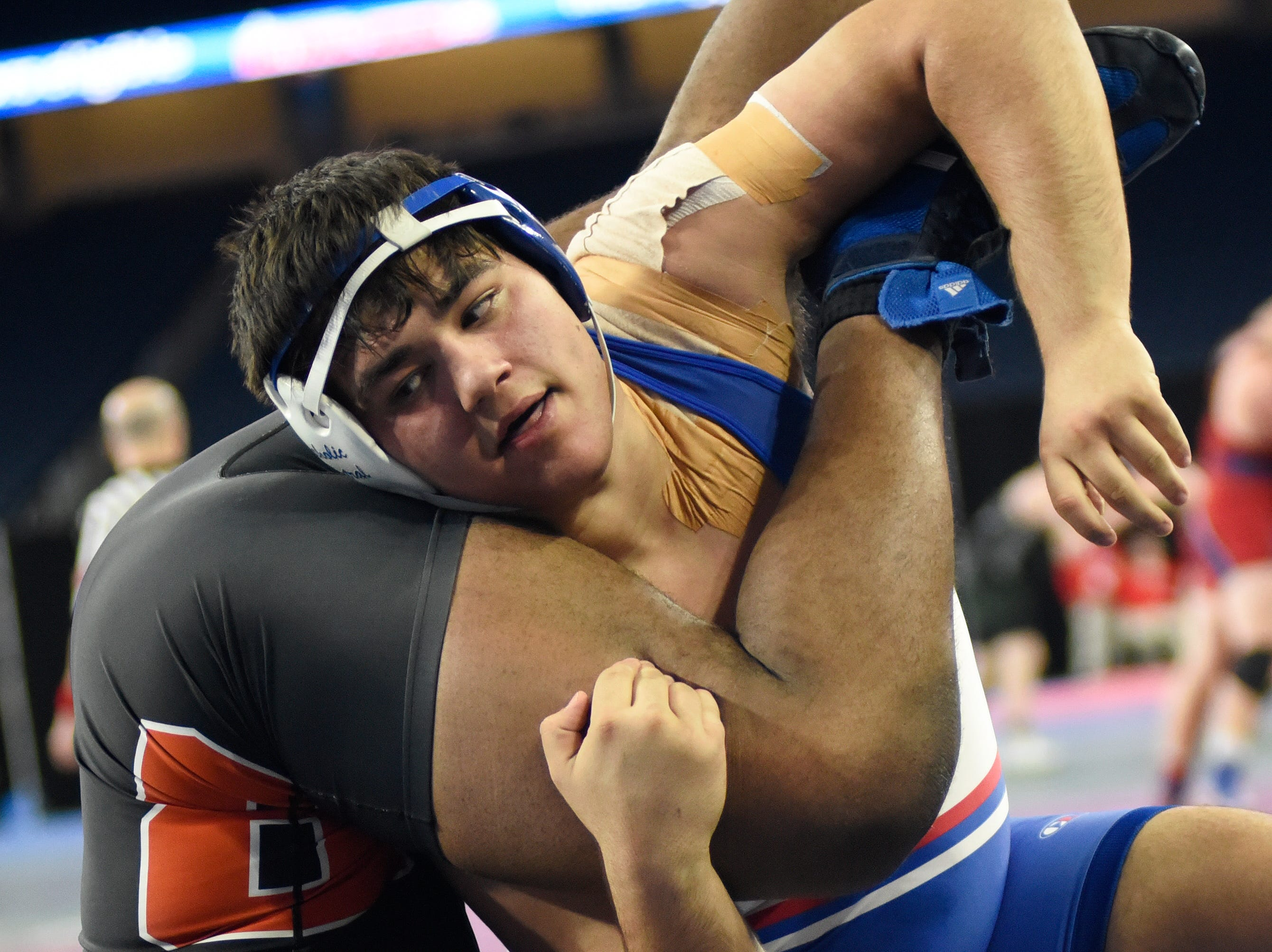Steven Kolcheff of Detroit Catholic Central, top, wrestles Jaden Rice of Belleville in the 285 pound weight class semifinal. Kolcheff won by pin.