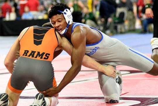 Kevon Davenport of Detroit Catholic Central, right, wrestles with Jack Richardson of Rockford at 145 pounds.  Davenport won by pin over Richardson.