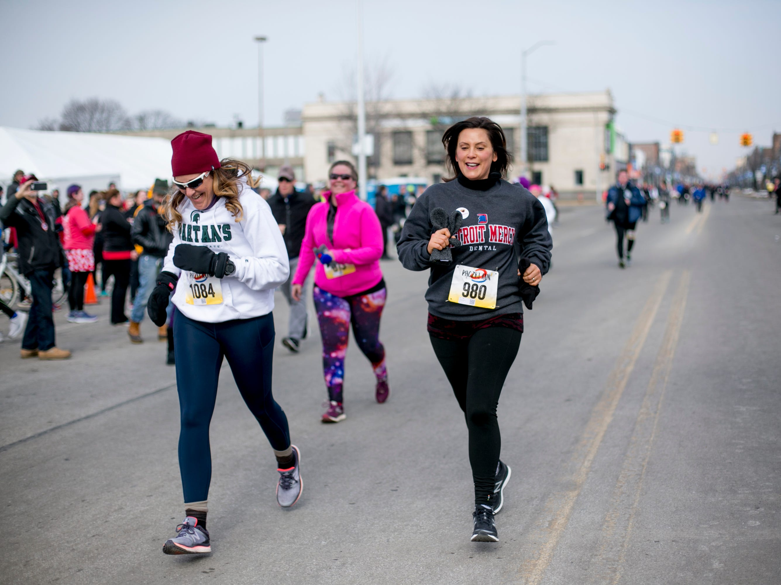 Gov. Gretchen Whitmer finishes  the 7th annual Tour-de-Troit Paczki Run in Hamtramck on March 2, 2019.