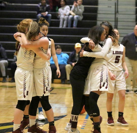 Caylee Boorse, far left, hugs Elmira teammate Tess Arnold as Kiara Fisher, third from left, hugs Zaria DeMember-Shazer after the Express beat Binghamton in the Section 4 Class AA championship game March 1, 2019 at Corning-Painted Post High School.
