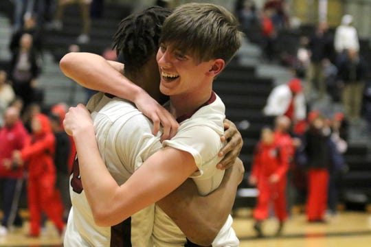 Daijuvon Warren, left, of Elmira hugs teammate Nolan Collins after the Express beat Binghamton the Section 4 Class AA boys basketball final March 1, 2019 at Corning-Painted Post High School.