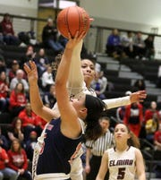 Zaria DeMember-Shazer of Elmira blocks a shot by Binghamton's Mia Ryan during the Section 4 Class AA girls basketball championship game March 1, 2019 at Corning-Painted Post High School.