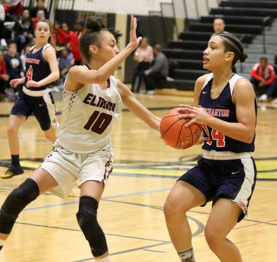 Nurah Aziz-Gower of Binghamton looks for room as Jalea Abrams of Elmira defends during the Section 4 Class AA girls basketball championship game March 1, 2019 at Corning-Painted Post High School.