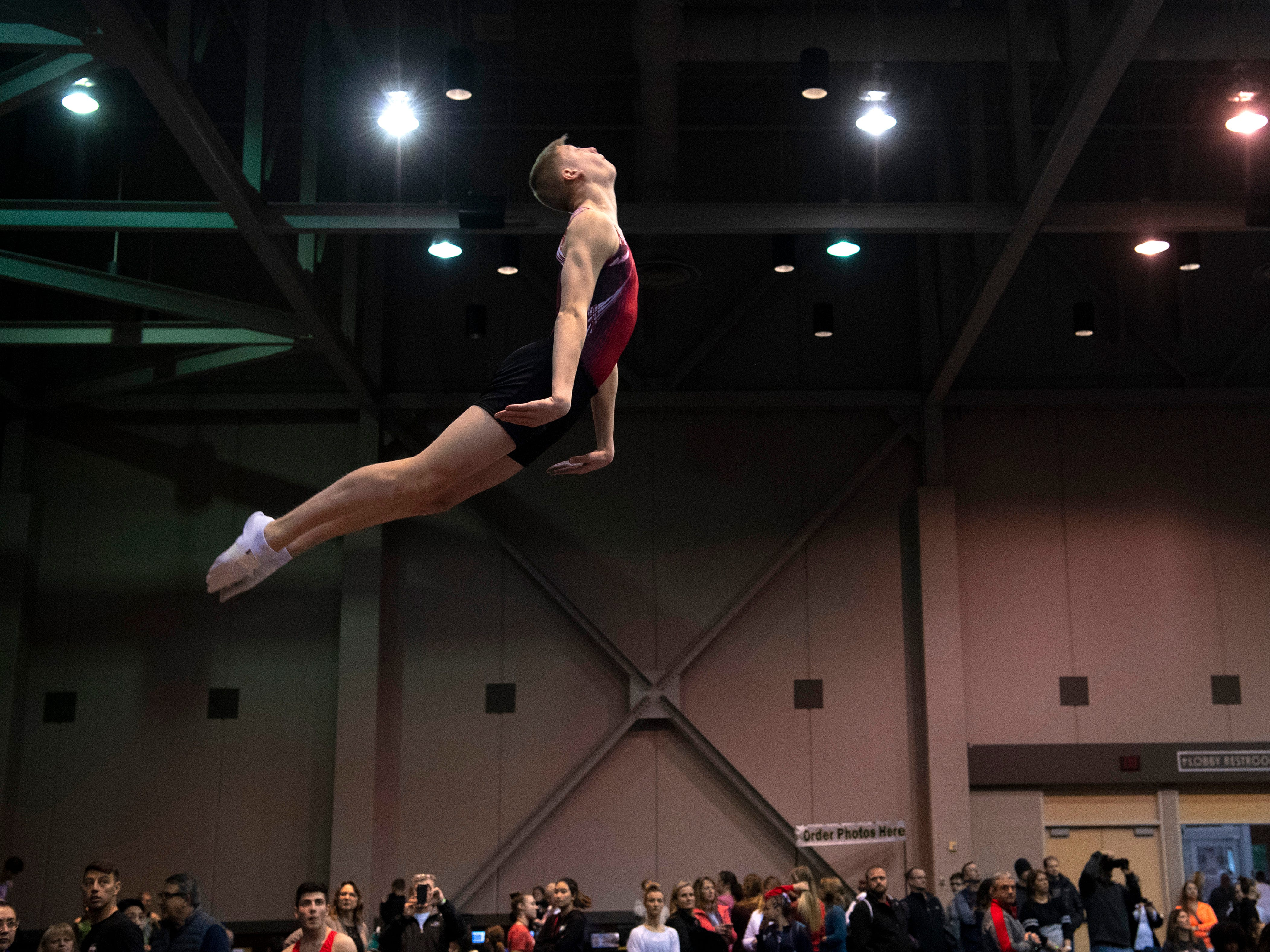 A gymnast competes in the double-mini trampoline competition at the VIP Classic at the Old National Events Plaza Friday afternoon.