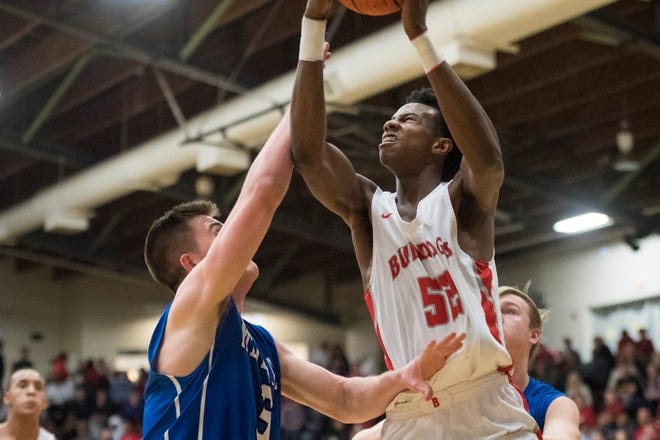 Bosse's Kiyron Powell (52) takes a shot during the 2019 IHSAA Class 3A Basketball Sectional Tournament at Boonville High School Friday, March 1, 2019.