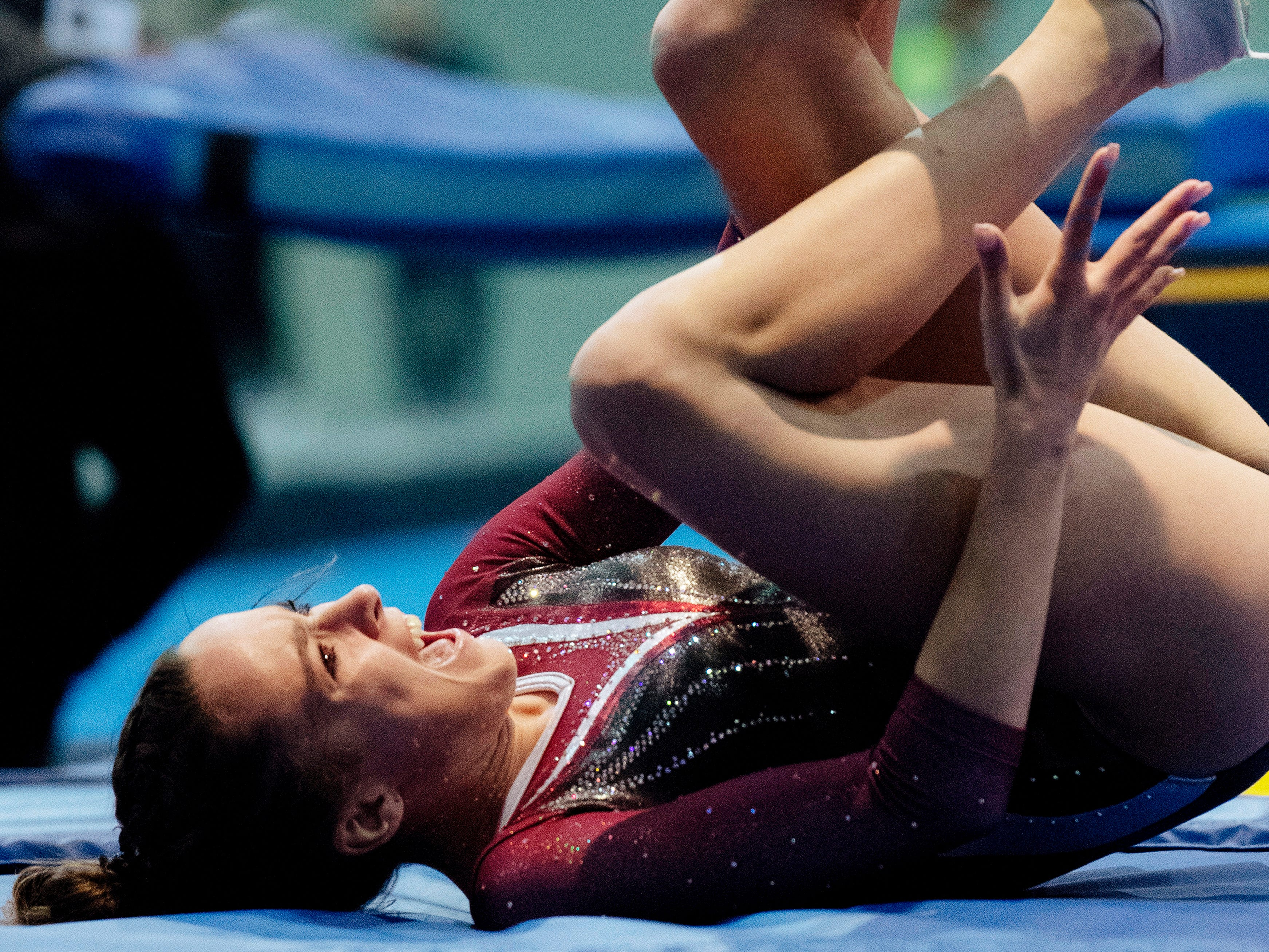 Central Illinois Athletics' Ava Pollard, 14, grabs for her ankle after landing wrong on her double-mini trampoline attempt during a at the VIP Classic at the Old National Events Plaza Friday afternoon.