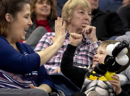 "Colton ""Batman"" Martin, 3, plays a game with his grandmother, Teri Martin, before the start of the Thunderbolts game at the Ford Center earlier this season."