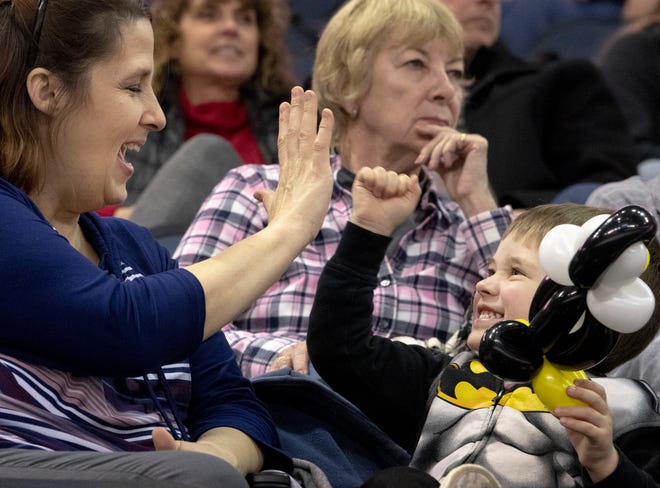 """Colton """"Batman"""" Martin, 3, plays a game with his grandmother, Teri Martin, before the start of the Thunderbolts game at the Ford Center earlier this season."""