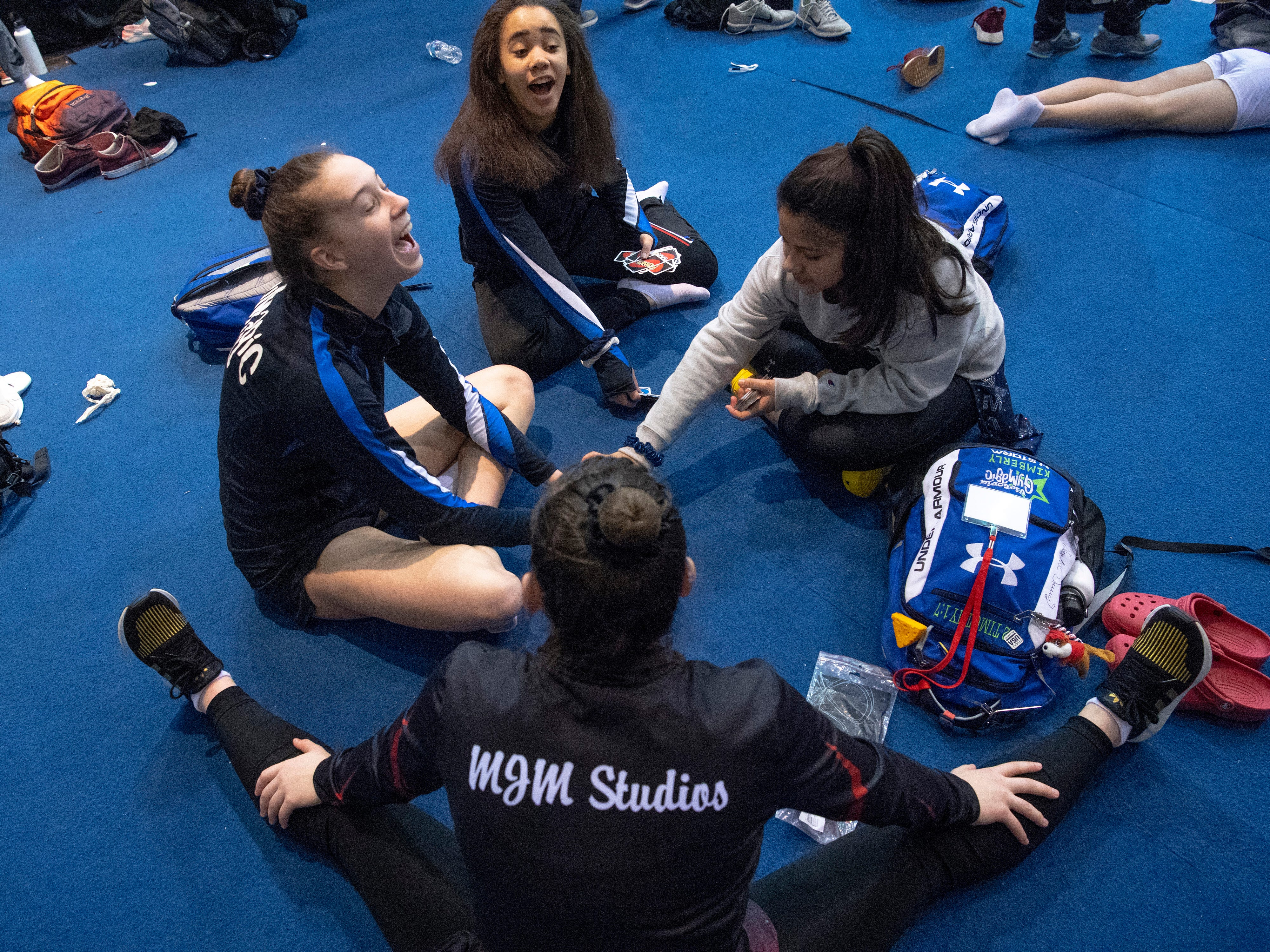Competitors start a game of Uno in the warm-up area at the VIP Classic at the Old National Events Plaza Friday afternoon. The girls are, from bottom, Erin Dirr, 16, of Alexandria, Ky., Kimberly Tipton, 16, Krista McNary, 14, and Isabela Garza, 15, all of Victoria, Tex.
