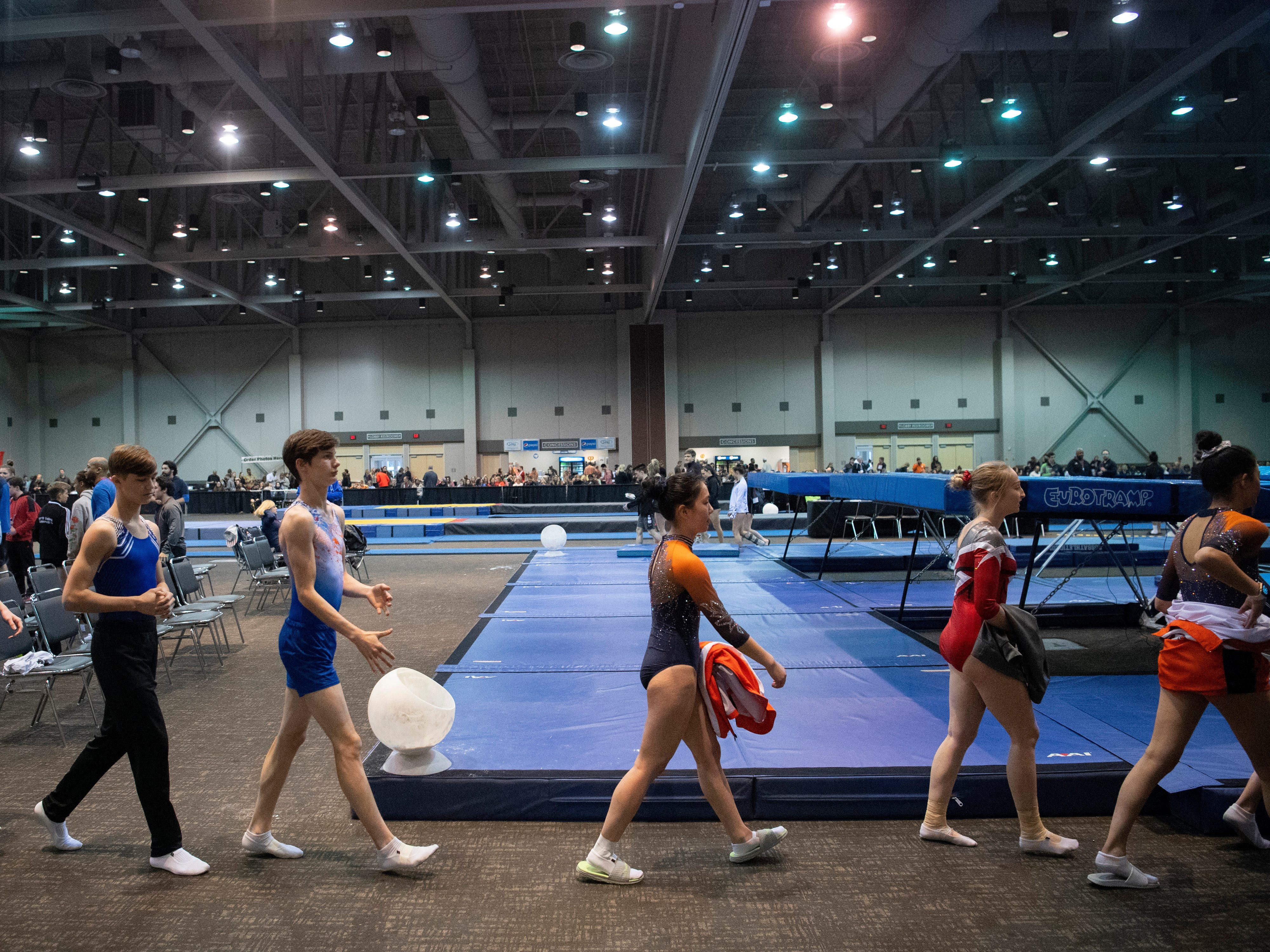 Trampoline gymnasts prepare to compete in at the VIP Classic at the Old National Events Plaza Friday afternoon.